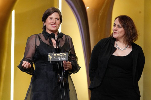 Producer Sue Maslin and director Jocelyn Moorhouse accept one of their AACTA Awards