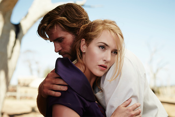 Kate Winslet and Liam Hemsworth in still from The Dressmaker - Tilly and Teddy embrace, The Dressmaker